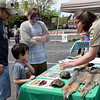 Park manager trainee Rachel Eckman shares information at the Perkaise popup park Saturday, April 22.  Debby High — For Digital First Media