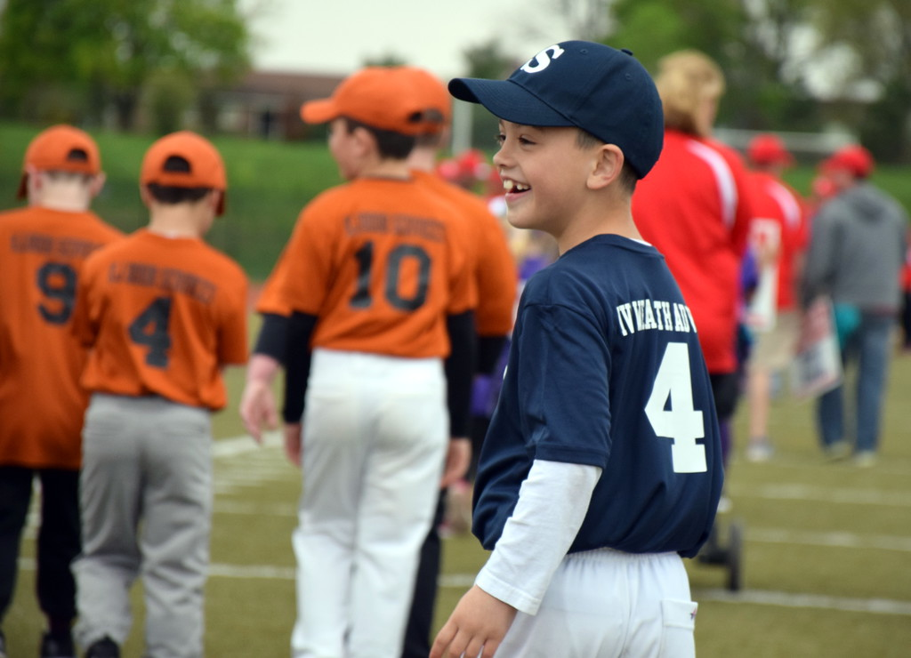 . AJ Pisoni walks on the field with his team during Souderton Area Baseball League�s opening day ceremony Saturday, April 22. Debby High � For Digital First Media