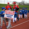 Teams march into the Souderton Area Baseball League's opening day ceremony Saturday, April 22. Debby High — For Digital First Media