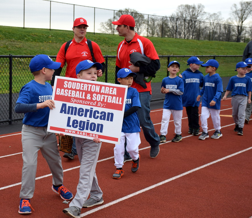 . Teams march into the Souderton Area Baseball League�s opening day ceremony Saturday, April 22. Debby High � For Digital First Media