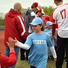 Souderton Area High School players greet Souderton Area Baseball League players as they march onto the field during the opening day ceremony Saturday, April 22. Debby High — For Digital First Media