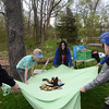 Community members bounce stuffed animals using a makeshift parachute April 22 during the Jarrett Nature Center's 15th anniversary and Earth Day celebration.  Christine Wolkin — For Digital First Media