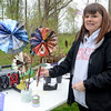Hatboro-Horsham High School teacher Mary Arbuckle assembles paper flowers from recycled materials at the Jarrett Nature Center's 15th anniversary and Earth Day celebration April 22.  Christine Wolkin — For Digital First Media