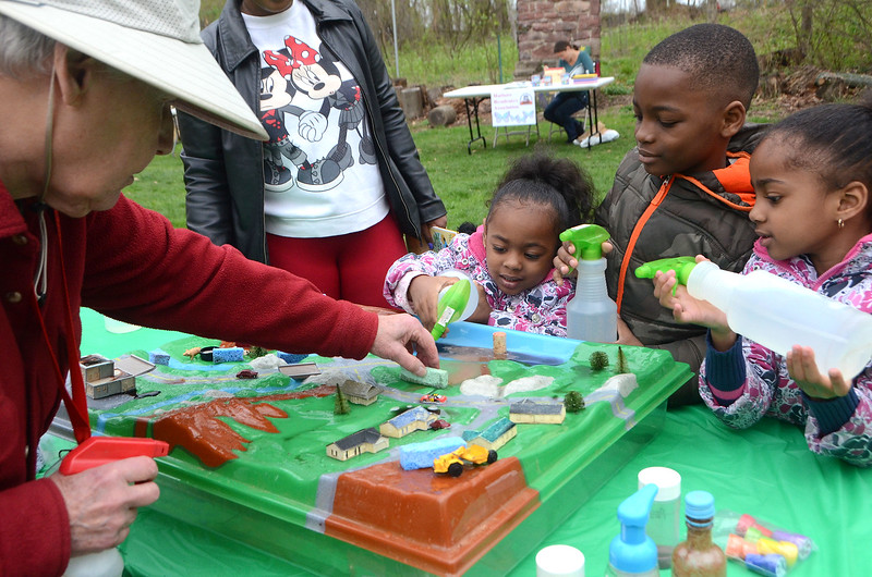 Marjory Eboy of the Jarrett Nature Center, left, teaches Jayln, Javon and Jayla Butter, of Horsham, about our ecosystem and sustainability during the Jarrett Nature Center's celebration to mark its 15th anniversary and Earth Day April 22.  Christine Wolkin — For Digital First Media