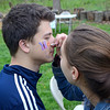 Hatboro-Horsham High School student Maddy Maiers, right, paints a rainbow on fellow student Ayhan Usein's face at the Jarrett Nature Center's 15th anniversary and Earth Day celebration April 22.  Christine Wolkin — For Digital First Media