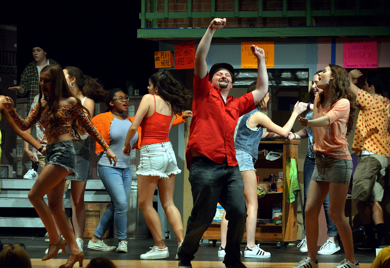 Usnavi (Jeffrey Pfeiffer),  the bodega owner who sold the winning lottery ticket, and the residents of the barrio dream of what they would do if they had won the prize money.  (Bob Raines/Digital First Media)