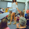 Karyl Bruno hits the runway during the fashion show at Sister U's Best Foot Forward event at the Upper Bucks campus of Bucks County Community College Saturday, April 29.  Debby High — For Digital First Media