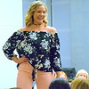 A model hits the runway during the fashion show at Sister U's Best Foot Forward event at the Upper Bucks campus of Bucks County Community College Saturday, April 29.  Debby High — For Digital First Media