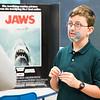 "Fifth-grader AJ Garretson poses as film director Steven Spielberg for Erdenheim Elementary School's wax museum. A ""Jaws"" poster behind Garretson provides a visual for one of Spielberg's best known flicks.  Rachel Wisniewski — For Digital First Media"