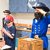 """Aidan Eurnette, right, stands at attention as George Custer, a United States Army officer and calvary commander in the American Civil War. While waiting for parents to come by and press a """"play"""" button on their desks, students stayed frozen in a pose appropriate to their character. To Eurnette's left stands Max Hershey as famed baseball player Babe Ruth.  Rachel Wisniewski — For Digital First Media"""