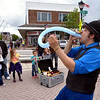 Magician Doug Stafford swallows a balloon on the plaza at Madison and Main Streets during Lansdale's First Friday May 5, 2017.  (Bob Raines/Digital First Media)