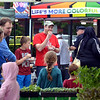 People grab something to eat and cruise the booths at the plaza at Madison and Main Streets during Lansdale's First Friday May 5, 2017.  (Bob Raines/Digital First Media)