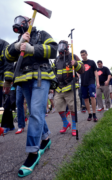 . Barren Hill firefighters trade boots for pumps as they take part in the Walk A Mile In Her Shoes event benefiting Laurel House in Heebner Park, Worcester May 6, 2017.  (Bob Raines/Digital First Media)