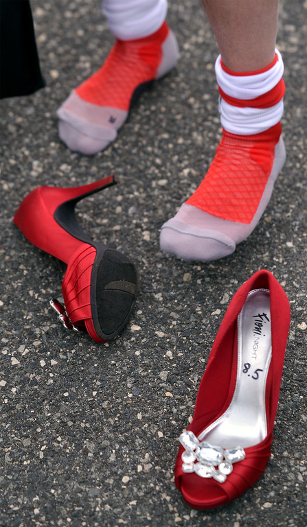 . Some walkers who were issued tall stilettos waited until starting time before putting on their shoes for the Walk A Mile In Her Shoes event benefitting Laurel House at Heebner Park, Worcester May 6, 2017.  (Bob Raines/Digital First Media)