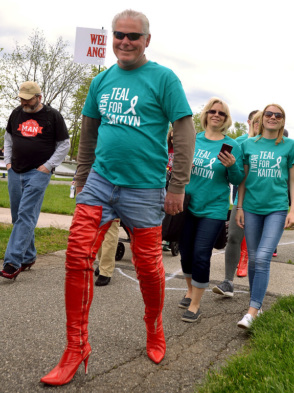 . One member of the Wear Teal for Kaitlyn team got to wear a pair of red thigh-high stiletto-heeled boots for the Walk A Mile In Her Shoes event benefiting Laurel House held at Heebner Park, Worcester May 6, 2017.  (Bob Raines/Digital First Media)