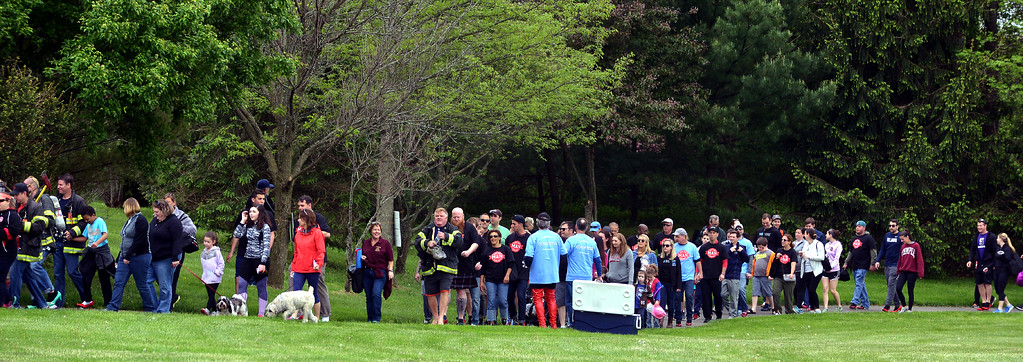 . Walkers take part in the Walk A Mile In Her Shoes event benefiting Laurel House some water as they each the halfway point of their first lap around Heebner Park, Worcester May 6, 2017.  (Bob Raines/Digital First Media)