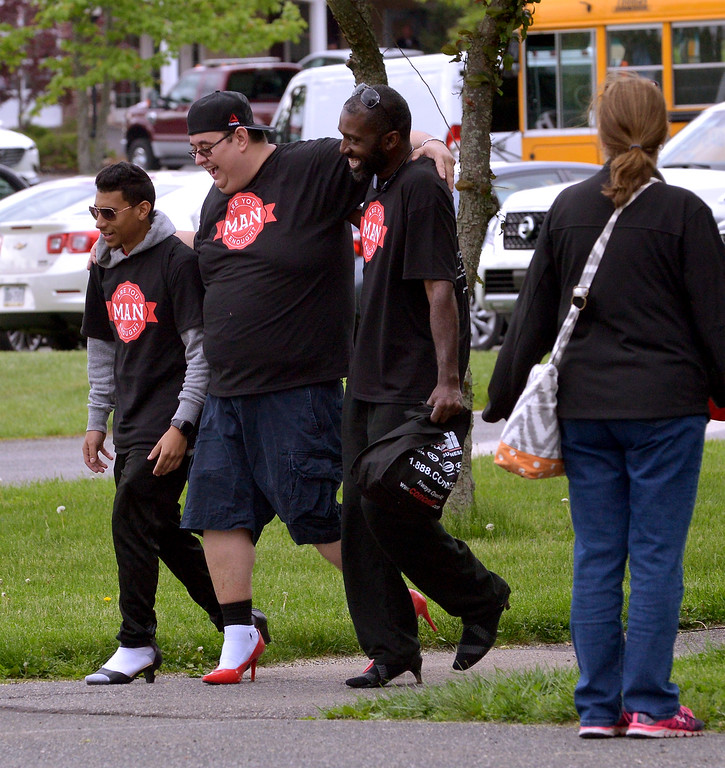. Three walkers provided mutual support as they near the start of their second lap around Heebner Park in the Walk A Mile In Her Shoes event to benefit Laurel House May 6, 2017.  (Bob Raines/Digital First Media)