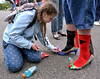 Johanna Jacobs decorates Chris Gregor's before the Walk A Mile In Her Shoes event benefitting Laurel House at Heebner Park, Worcester May 6, 2017.  (Bob Raines/Digital First Media)