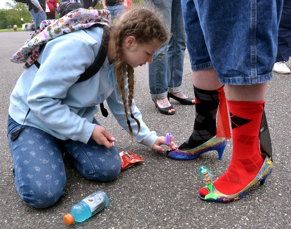 . Johanna Jacobs decorates Chris Gregor\'s before the Walk A Mile In Her Shoes event benefitting Laurel House at Heebner Park, Worcester May 6, 2017.  (Bob Raines/Digital First Media)
