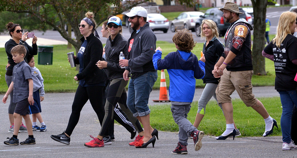 . Men in high heels walk around Heebner Park as part of the Walk A Mile In Her Shoes event to benefit Laurel House May 6, 2017.  (Bob Raines/Digital First Media)