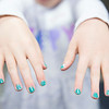 Emma Morton, 9, shows off her newly painted nails.  Rachel Wisniewski — For Digital First Media