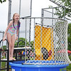 Sophia Maneely, of Jenkintown, braves the chilly weather and volunteers at the dunk tank during the Jenkintown Red and Blue Fair at Jenkintown Elementary School May 20.  Christine Wolkin — For Digital First Media