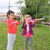 Nora Kimball, left, and Chloe William, both 5, of Jenkintown, try their hands at archery during the Jenkintown Red and Blue Fair at Jenkintown Elementary School May 20.  Christine Wolkin — For Digital First Media