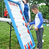 Young Vilsmeier, 7, of Jenkintown, plays Plinko during the Jenkintown Red and Blue Fair at Jenkintown Elementary School May 20.  Christine Wolkin — For Digital First Media