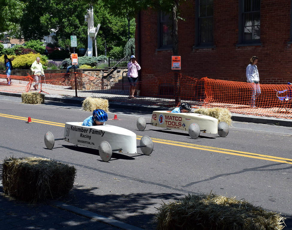 . Carson Kolumber and Aaron Heck are neck and neck as they race to the finish line of the Indian Valley Soap Box Derby in Souderton Saturday, June 3.  Debby High � For Digital First Media
