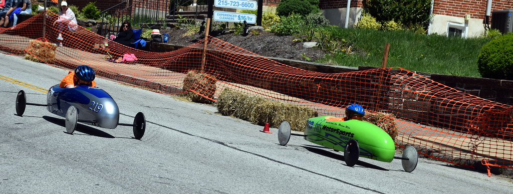 . Jack Bakey and Madison Miller race down Main Street during the Indian Valley Soap Box Derby in Souderton Saturday, June 3.  Debby High � For Digital First Media