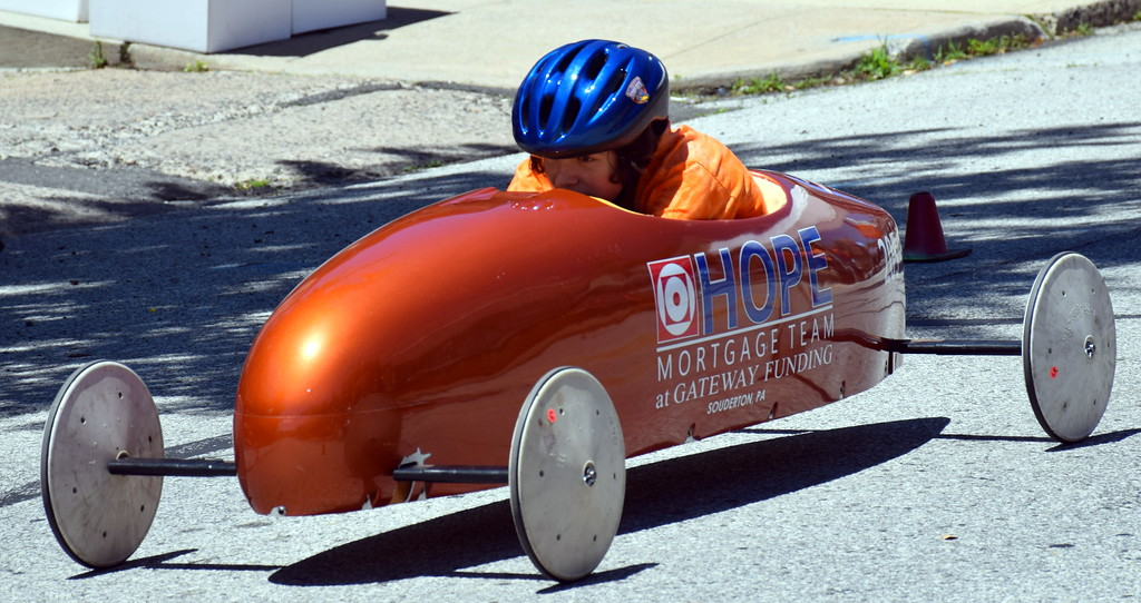 . A driver races down Main Street in Souderton during the annual Indian Valley Soap Box Derby Saturday, June 3.  Debby High � For Digital First Media