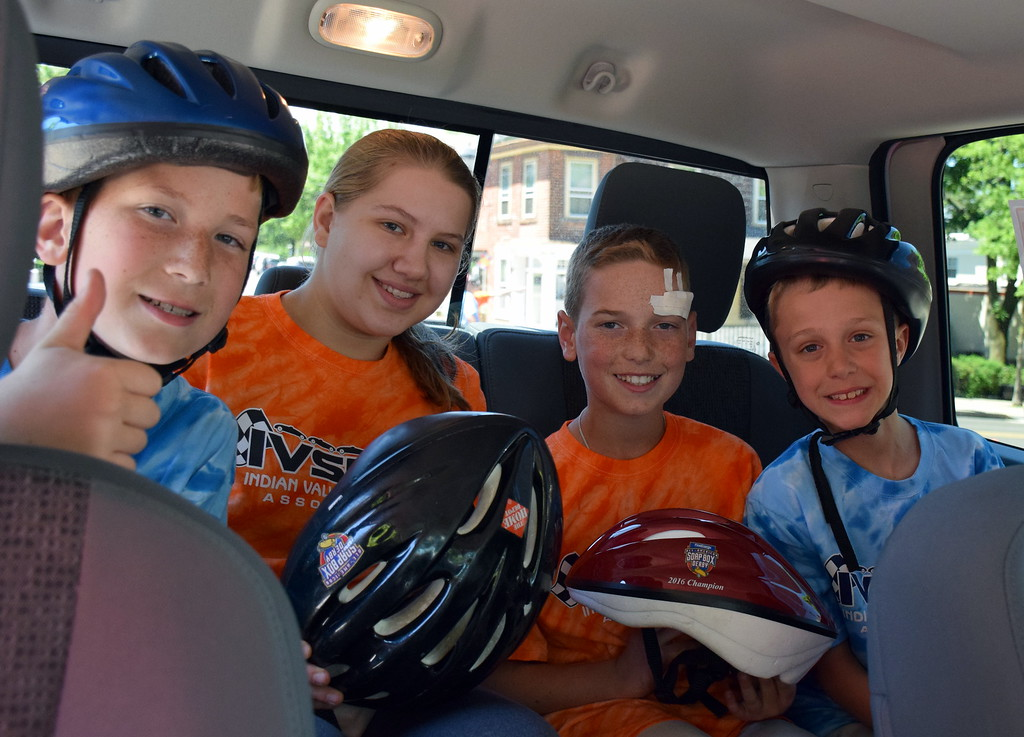 . Carson Kolumber, Allyson Gilton, Luke Kolumber and Aaron Heck participate in the Indian Valley Soap Box Derby in Souderton Saturday, June 3.  Debby High � For Digital First Media