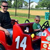 Derek Ketterer and his son, Drew, take a drive with Mickey at the 18th annual Dublin Day Saturday, June 3.  Debby High — For Digital First Media
