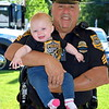 Dublin police Sgt. William Kirk and his granddaughter, Grace Deakin, attend the 18th annual Dublin Day Saturday, June 3.  Debby High — For Digital First Media