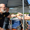 Andrew Kenchel, brewer/owner of Bucks County Brewery, serves drinks during the 18th annual Dublin Day Saturday, June 3.  Debby High — For Digital First Media