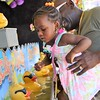Miley Moore, with the help of her grandfather, Kenneth Moore, both of Germantown, picks out a rubber ducky during the June Fete Fair June 11.  Christine Wolkin — For Digital First Media