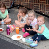 Carleigh Warner, of Horsham, left, Maizey Haggerty, of Ambler, Cameron Warner, of Horsham, and Carson Warner, of Horsham, enjoy the street food during Ambler's Arts & Music Festival June 16.  Christine Wolkin — For Digital First Media