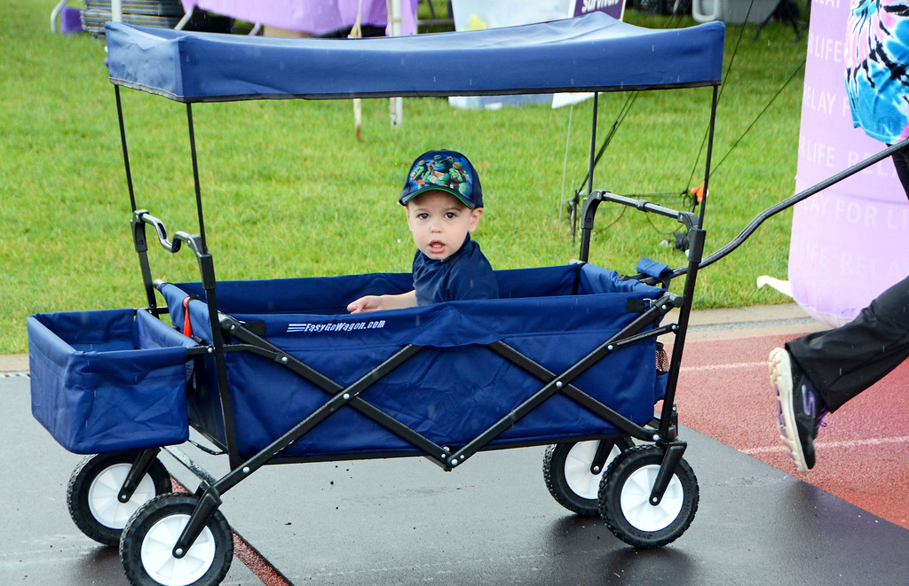 . Xander Brower, of Souderton, takes a trip around the track during the North Penn Relay for Life at the high school\'s Crawford Stadium Saturday, June 17.  Christine Wolkin - For Digital First Media