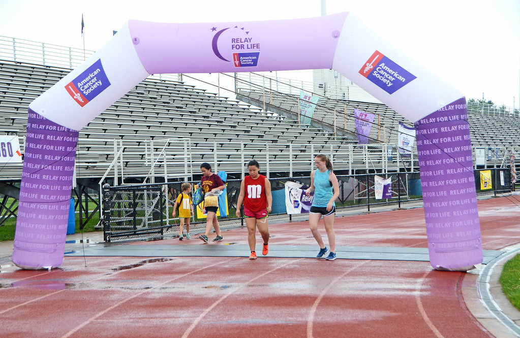 . Walkers pass beneath the archway during the North Penn Relay for Life at the high school\'s Crawford Stadium on Saturday, June 17.  Christine Wolkin - For Digital First Media