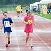 Runners brave the stormy weather during the North Penn Relay for Life at the high school's Crawford Stadium on Saturday, June 17.  Christine Wolkin - For Digital First Media