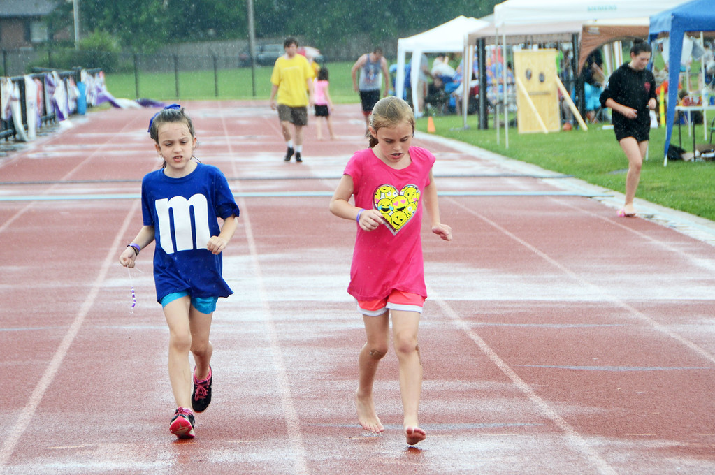 . Runners brave the stormy weather during the North Penn Relay for Life at the high school\'s Crawford Stadium on Saturday, June 17.  Christine Wolkin - For Digital First Media
