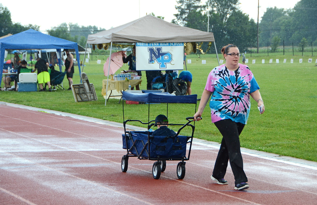 . Ashley Brower, of Souderton, pulls her son, Xander Browe,r along on the track during the North Penn Relay for Life at the high school\'s Crawford Stadium Saturday, June 17.  Christine Wolkin - For Digital First Media