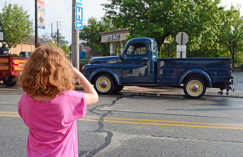 Abby Hendricks, of Souderton, takes a photo of a pickup truck that caught her attention during Lansdale's Under the Lights Car Show Saturday, June 16.  Christine Wolkin - For Digital First Media