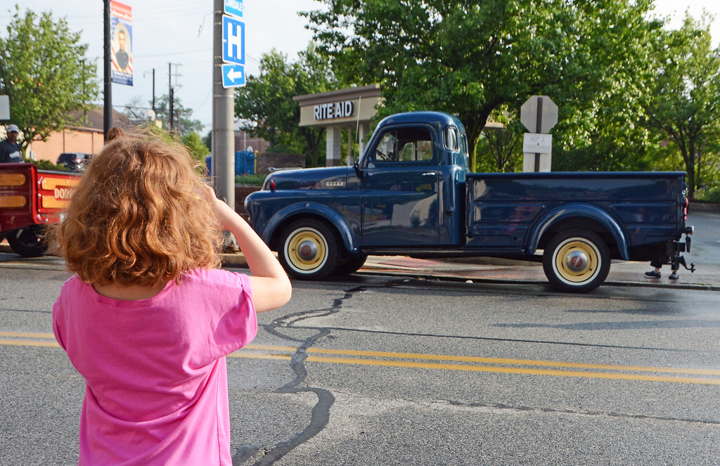 . Abby Hendricks, of Souderton, takes a photo of a pickup truck that caught her attention during Lansdale\'s Under the Lights Car Show Saturday, June 16.  Christine Wolkin - For Digital First Media