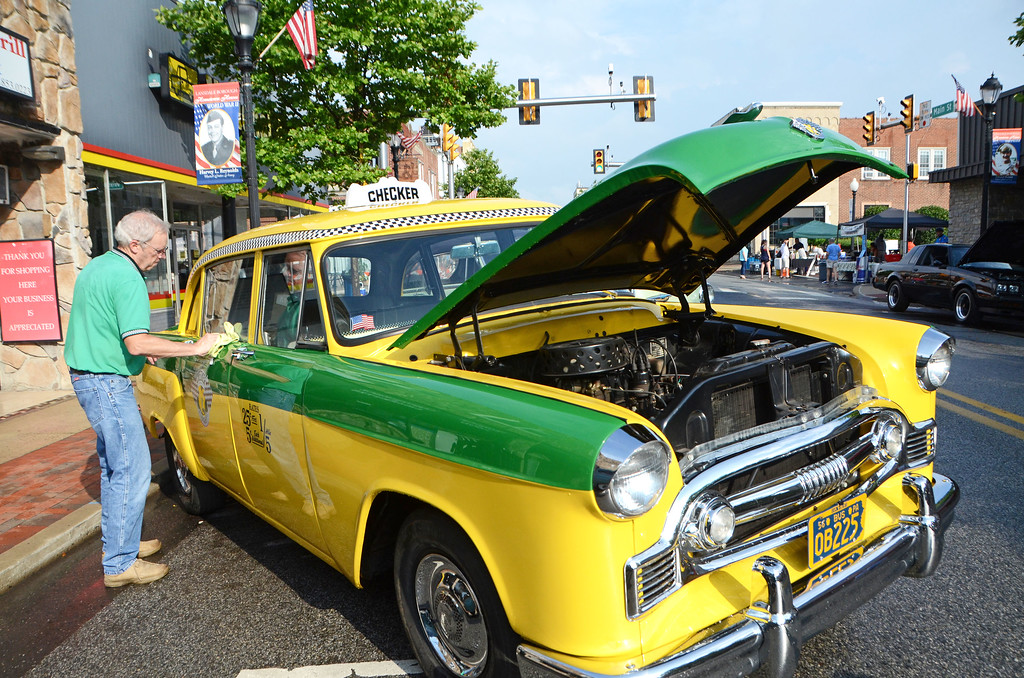 . Bruce Uhrich buffs up his 1956 Checker Taxi during Lansdale\'s Under the Lights Car Show Saturday, June 16.  Christine Wolkin - For Digital First Media