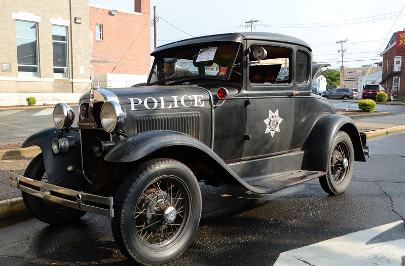A 1940 Ford A police cruiser sits just down the block from the Lansdale Police Station during Lansdale's Under the Lights Car Show Saturday, June 16.  Christine Wolkin - For Digital First Media