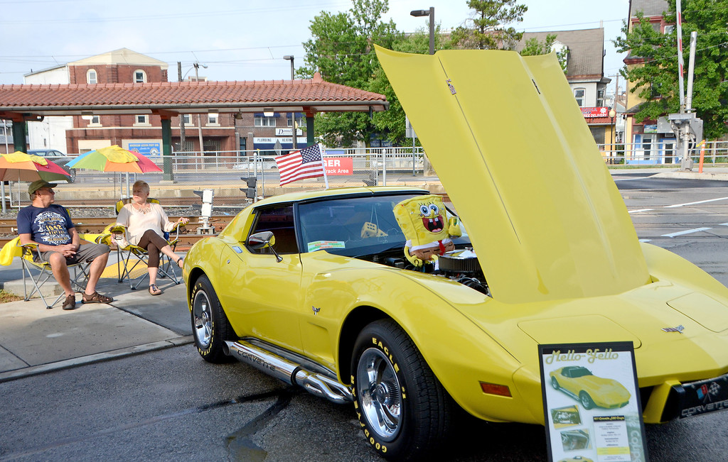 . Bonnie Stroup\'s yellow 1977 Chevy Corvette caught the eye of both young and old car enthusiasts during Lansdale\'s Under the Lights Car Show Saturday, June 16.  Christine Wolkin - For Digital First Media