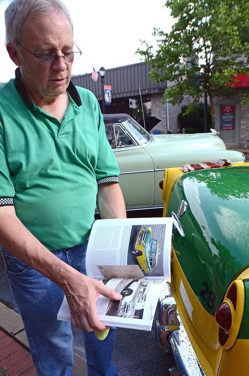 . Bruce Uhrich shares an antique cars booklet featuring his 1956 Checker Taxi during Lansdale\'s Under the Lights Car Show Saturday, June 16.  Christine Wolkin - For Digital First Media