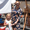 Pam Schaible poses with her daughter, Teaghan, at the Splash Lab Arts booth, where children could get creative.  Rick Cawley — For Digital First Media