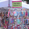 Lily Fabric displays handcrafted items at the Manayunk Arts Festival.  Rick Cawley — For Digital First Media